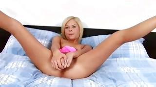 Sexy hot blonde slut is posing stripped on the bed