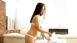Brunette sexually sweet bitch is posing in hot underwear
