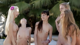 Several nude hotties are posing misbehaving outdoors