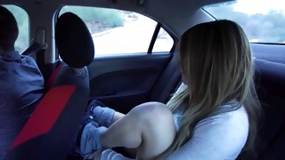 Long haired kinky slut is posing sexually nice in the car
