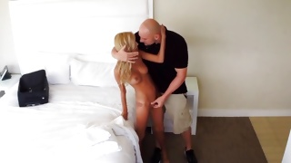Blonde whore is on her knees swallowing a donger