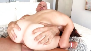 Bald guy is hammering this naked babe rough