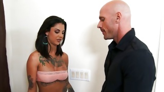 Bald headed dude opening the doors for sexy lady