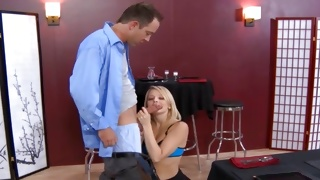 Blonde chick is smiling while talking to mature