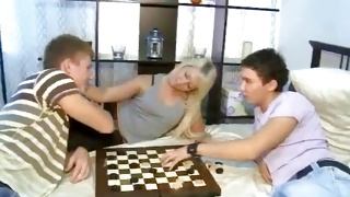 Light haired furious beauty is playing chess