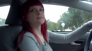 Look at on sexually wild and sexy red haired tramp is posing in the car
