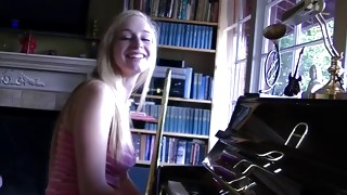 This blonde delicate actress is playing a piano looks really sexually
