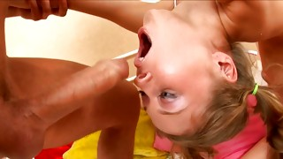 Lucky haired cute chick looks sexually while lying on the floor