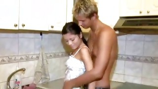 This creepy bitch is kneeling and giving him the lusty blowjob
