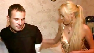 Whorish light-haired babe in sexy underwear is touched by dude